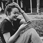 girl laughing at her phone